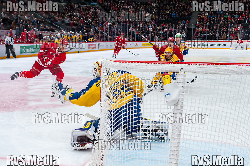 LAUSANNE, SWITZERLAND - NOVEMBER 05: #30 Goalie Joren van Pottelberghe of HC Davos makes a save from shot #25 Cory Emmerton of Lausanne HC during the Swiss National League game between Lausanne HC and HC Davos at Vaudoise Arena on November 5, 2019 in Lausanne, Switzerland. (Photo by Robert Hradil/RvS.Media)