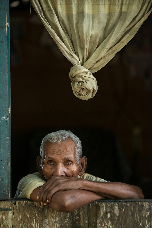 Old Man in window<br /> Gam Island<br /> Raja Ampat<br /> Coral triangle<br /> Indonesia