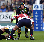Northampton, Northamptonshire,  18th September 2004, Franklyn Gardens, [Mandatory Credit Pete Spurrier/Intersport Images]Zurich Premiership - Northampton - Saints vs Gloucester. <br /> <br /> Selborne Boome, is tackled head on and low by Gloucester's Nock Wood.