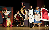 The Red Queen (Marissa Leyland), King of Hearts (Clark Roberts), Rabbit (Daniel Kehr), Playing Cards (Allyson McGuire and Cassie Nichols), and Alice (Olivia Martinson) during Wednesday's dress rehearsal for Winnisquam Regional High School's production of Alice in Wonderland.   (Karen Bobotas/for the Laconia Daily Sun)