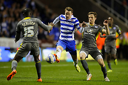 Chris Gunter (WAL) of Reading is challenged by Jeffrey Schlupp (GHA) of Leicester City and Andy King (WAL) of Leicester City - Photo mandatory by-line: Rogan Thomson/JMP - 07966 386802 - 14/04/2014 - SPORT - FOOTBALL - Madejski Stadium, Reading - Reading v Leicester City - Sky Bet Football League Championship.