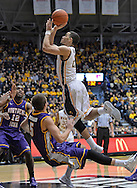 WICHITA, KS - JANUARY 05:  Guard Fred VanVleet #23 of the Wichita State Shockers drives to the basket over guard Matt Bohannon #5 of the Northern Iowa Panthers during the first half on January 5, 2014 at Charles Koch Arena in Wichita, Kansas.  Wichita State defeated Northern Iowa 67-53. (Photo by Peter Aiken/Getty Images) *** Local Caption *** Fred VanVleet;Matt Bohannon