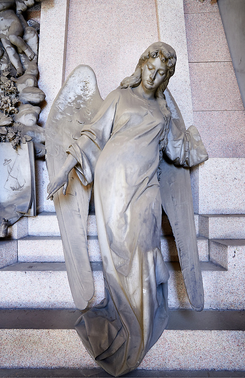 Picture and image of the stone sculpture of an angel guarding the pyramid shaped tomb with some Egyptian symbols of death which increases the sense of mystery. Tomb Gorlero sculptor E. Sclavi 1892. Section A, no 24, The monumental tombs of the Staglieno Monumental Cemetery, Genoa, Italy .<br /> <br /> Visit our ITALY PHOTO COLLECTION for more   photos of Italy to download or buy as prints https://funkystock.photoshelter.com/gallery-collection/2b-Pictures-Images-of-Italy-Photos-of-Italian-Historic-Landmark-Sites/C0000qxA2zGFjd_k<br /> If you prefer to buy from our ALAMY PHOTO LIBRARY  Collection visit : https://www.alamy.com/portfolio/paul-williams-funkystock/camposanto-di-staglieno-cemetery-genoa.html