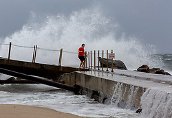 Sep 9, 2017 - Palm Beach Shores, Florida, U.S. - RYAN RALSTON stands on the jetty of the Palm Beach Inlet as he a friends took a closer look at the power Hurricane Irma. (Credit Image: © Greg Lovett via ZUMA Wire)