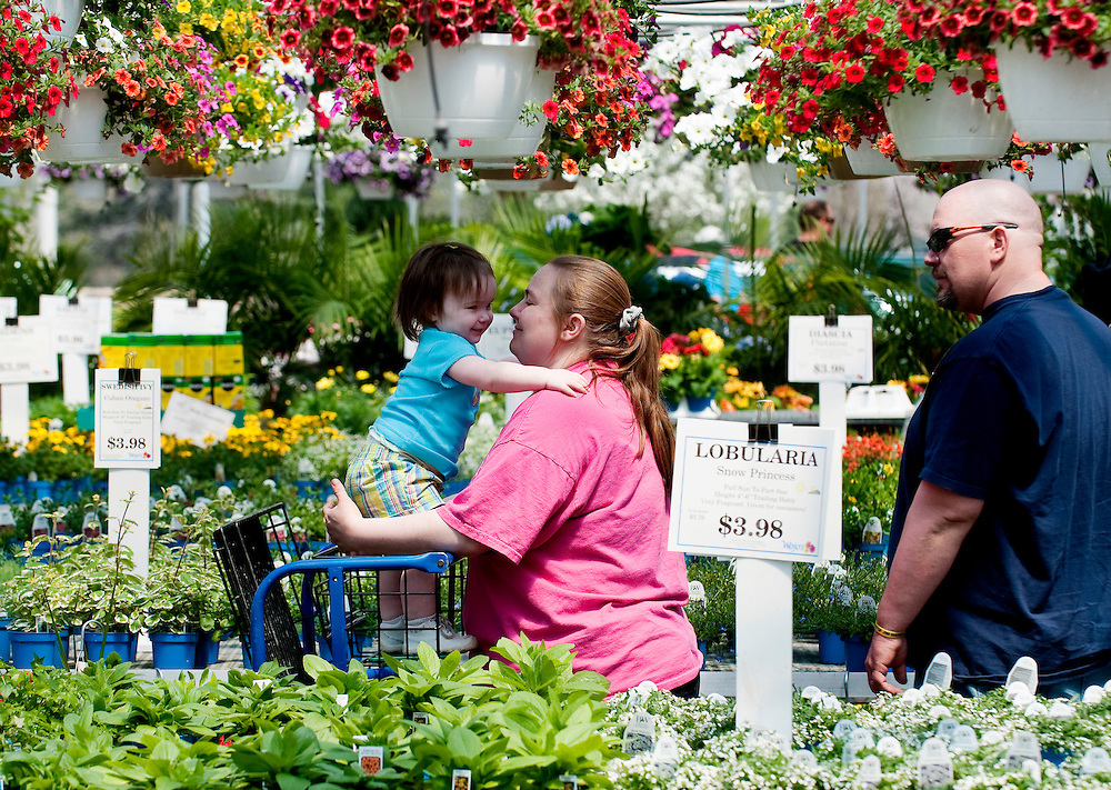 Matt Dixon   The Flint Journal..Jason and Christy Harris, of Genesee Township and their 18-month-old daughter Hailey shop for flowers at Wojo's Garden Splendors in Davison Township, Sunday afternoon. Mother's Day is one of the busiest days of the year for the store.