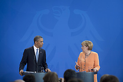 59860282    <br /> Barack Obama, president of the USA, and German Chancellor Angela Merkel (right) during a press call at a state visit of the Chancellery in Berlin, Germany. Barack Obama will walk in John F. Kennedy's footsteps this week on his first visit to Berlin as US president, but encounter a more powerful and sceptical Germany in talks on trade and secret surveillance practices. International Politics, Berlin, Germany on Wednesday 19 June, 2013. UK ONLY