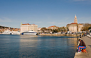 Fishing on the waterfront near the ferry terminal, Diocletian's Palace in the background, Split, Croatia