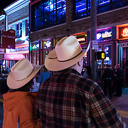 A couple walks the streets on Music Row in downtown Nashville, Tennessee on Friday, November 13, 2015. (Alex Menendez via AP)