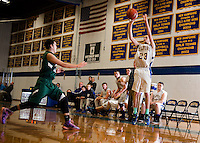 Gilford's Coby Goodwin takes a shot during NHIAA Division III basketball with Raymond on Tuesday evening.   (Karen Bobotas/for the Laconia Daily Sun)