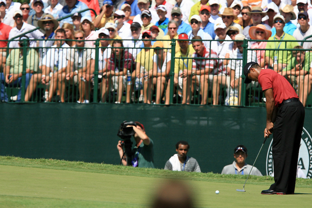12 August 2007: Tiger Woods makes a birdie putt on the 7th green during the final round of the 89th PGA Championship at Southern Hills Country Club in Tulsa, OK.