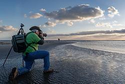 Photographer on beach, Gulf of Mexico, East Beach, Galveston, Texas, USA