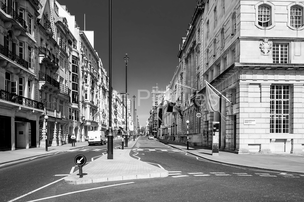 EDITORS NOTE: Image has been converted to black and white. Londons Pall Mall in the heart of the West End, is deserted due to lockdown as a result of the Coronavirus Pandemic on 16th April 2020 in London, United Kingdom. Coronavirus or Covid-19 is a new respiratory illness that has not previously been seen in humans. Much of Europe has been placed into lockdown, with stringent rules in place as part of a long term strategy, and in particular social distancing, and a stay at home policy.  Park Laneis deserted due to lockdown as a result of the Coronavirus Pandemic on 16th April 2020 in London, United Kingdom. Coronavirus or Covid-19 is a new respiratory illness that has not previously been seen in humans. Much of Europe has been placed into lockdown, with stringent rules in place as part of a long term strategy, and in particular social distancing, and a stay at home policy. photo by Mike Abrahams/In Pictures via Getty Images