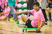 Milpitas High School sophomores struggle to find traction during the plunger race during the annual Trojan Olympics, where students compete in various unorthodox events for class bragging rights, at Milpitas High School in Milpitas, California, on March 27, 2015. (Stan Olszewski/SOSKIphoto)