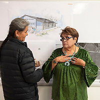 Glenda Davis, Program Manager for the Navajo Nation Animal Control Program, left, speaks with Crownpoint Chapter President Rita M. Capitan at the Crownpoint Chapter House as they look at plans for the Crownpoint Animal Shelter, Tuesday, Oct. 29 following the shelter's groundbreaking.