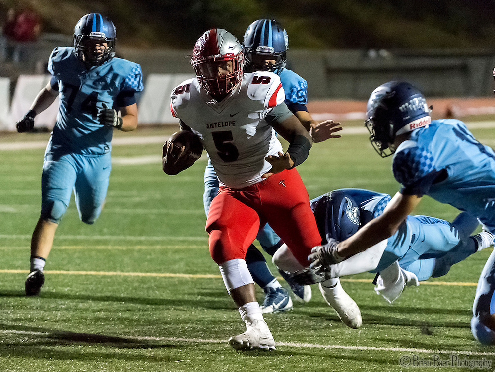 Antelope High School Titans Devin Dye (5), runs with the ball during the third quarter as the Oakmont High School Vikings host the Antelope High School Titans Friday Sep 30, 2016.<br /> photo by Brian Baer