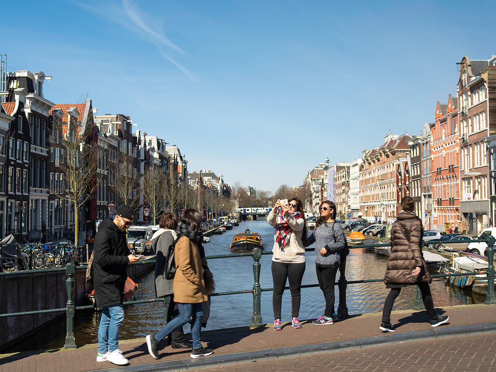 View of one of Amsterdam's many canals on a beautiful spring day.