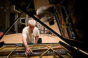 Israel, Jerusalem, The Henry Crown Symphony Hall, tuning a grand piano