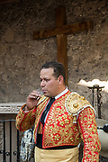 A Mexican Matador smokes a cigarette before entering the bull ring for the bullfights at the Plaza de Toros in San Miguel de Allende, Mexico.