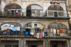 Washing hanging from balconies of ancient building in Havana; Cuba,