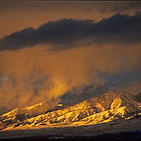 A winter storm clears at sunset over the Bridger Mountains above Bozeman, Montana.