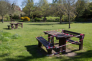 At the beginning of the fourth week of the UK government's lockdown during the Coronavirus pandemic, and with 120,067 UK reported cases with 16,060 deaths, taped off benches remain vacant in Ruskin Park, a green space in Lambeth, South London, on 20th April 2020, in London, England.