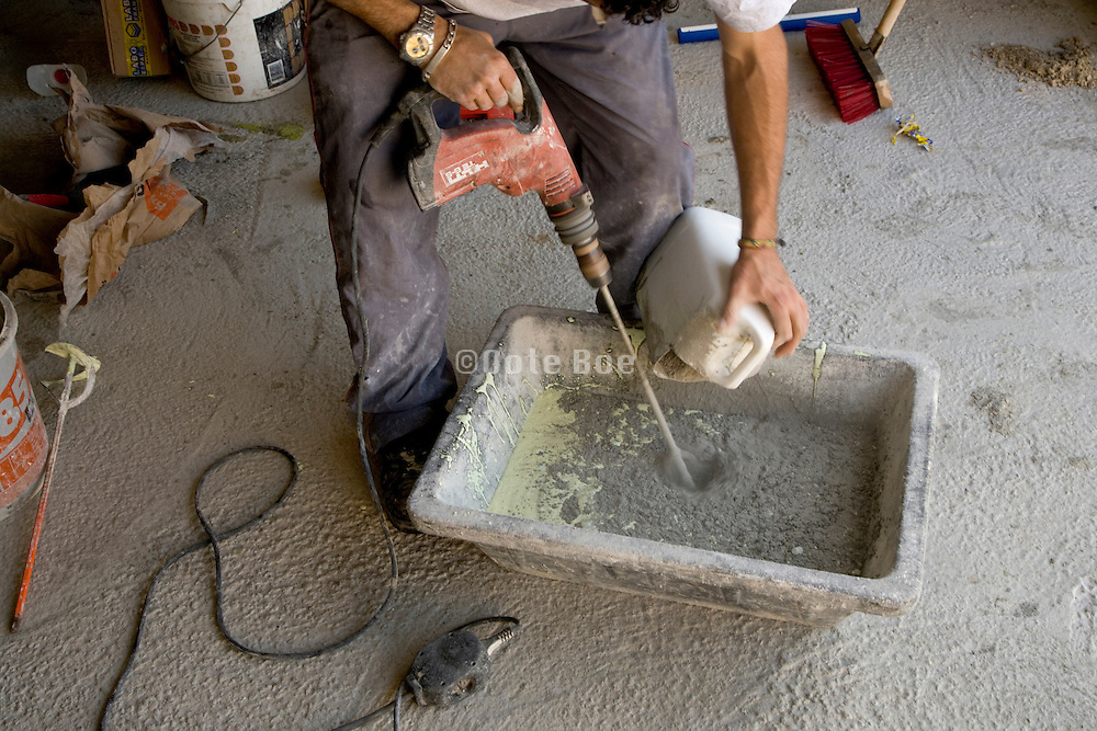 poring of cement with a chemical substance to make a waterproofing cement paste