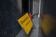 A misplaced Diversion sign left between buildings on 13th September 2016, in the City of London, England.