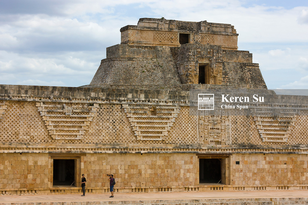Detail of the eastern building of the Nunnery Quadrangle, with Adivino pyramid showing behind, Uxmal, Yucatan, Mexico