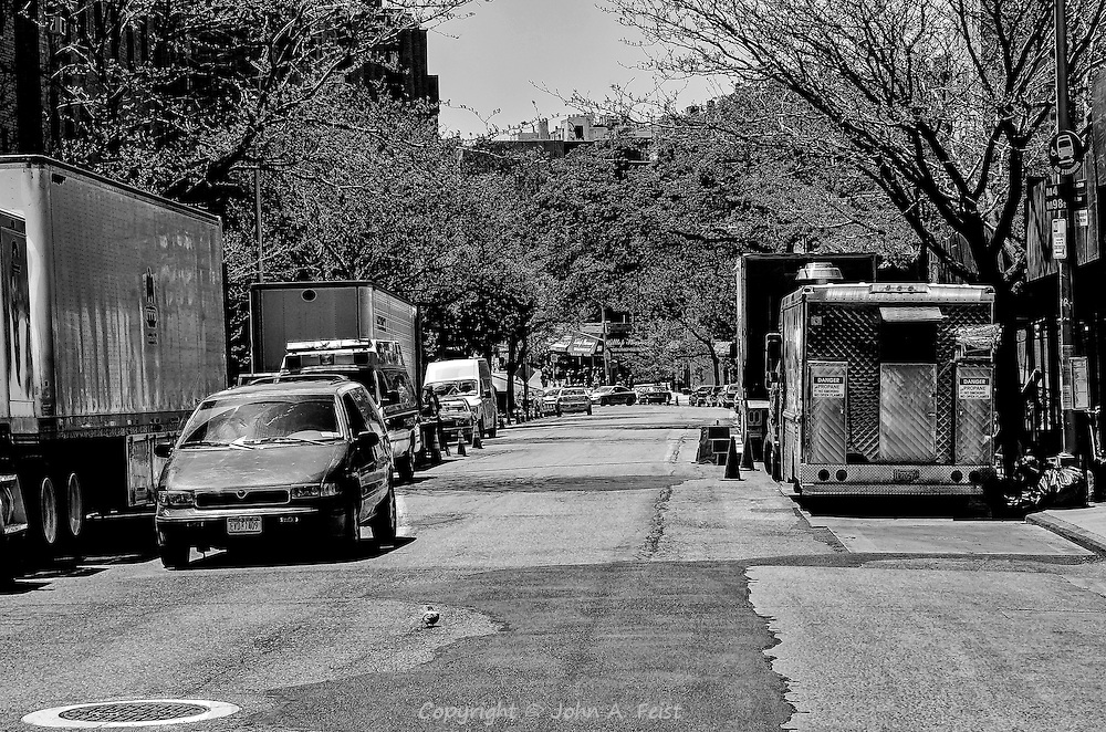 I was visiting my mom in Manhattan and by luck, there was a motion picture shoot going on down the street.  All of the vehicles in the picture are there for the shoot!  The intersection in the center of the image is about three city blocks from where I was standing.  That's where the action would eventually be.