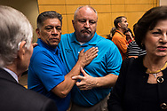 Mayor of Midland Jerry Morales, left, and Mayor of Odessa David Turner, right, embrace each other after a press conference at the University of Texas Permian Basin in Odessa, Texas, September 1, 2019. A gunman drove through the west Texas cities of Midland and Odessa the day before, fatally shooting seven people and injuring 25 others. The gunman was killed by police after leading them on a chase which ended at a nearby movie theater.
