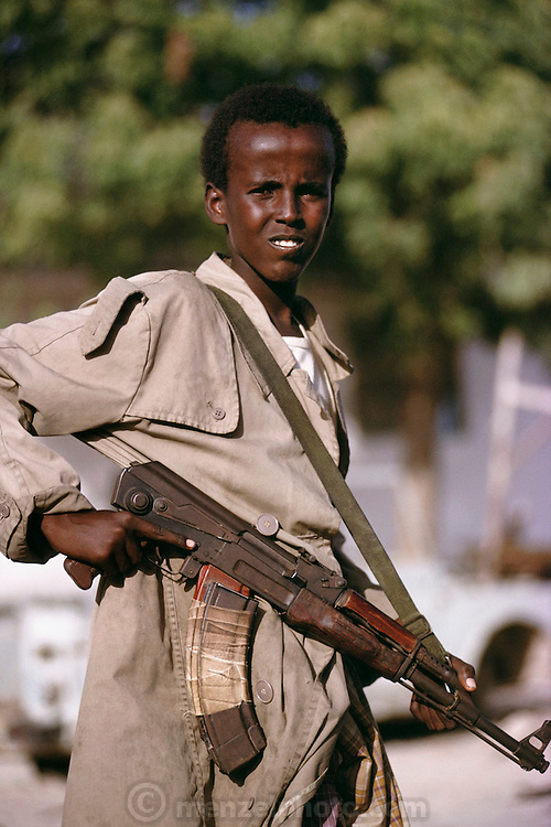 A teenage fighter for General Mohamed Farrah Aidid, on the south side of Mogadishu, the war-torn capital of Somalia. March 1992.