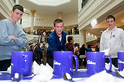 """Cadburys Spots vs Stripes Challenge Race Season Meadowhall Sheffield.Brett Riley, Ryan Kitchen and Billy McPherson try thier hand at the """"Fastest Tea Maker"""" Challenge.2 April 2011.Images © Paul David Drabble"""