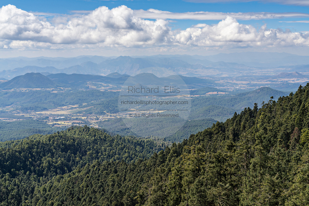 View over the Sierra Chincua Monarch Butterfly Biosphere Reserve near Angangueo, Michoacan, Mexico. The monarch butterfly migration is a phenomenon across North America, where the butterflies migrates each autumn to overwintering sites in Central Mexico.