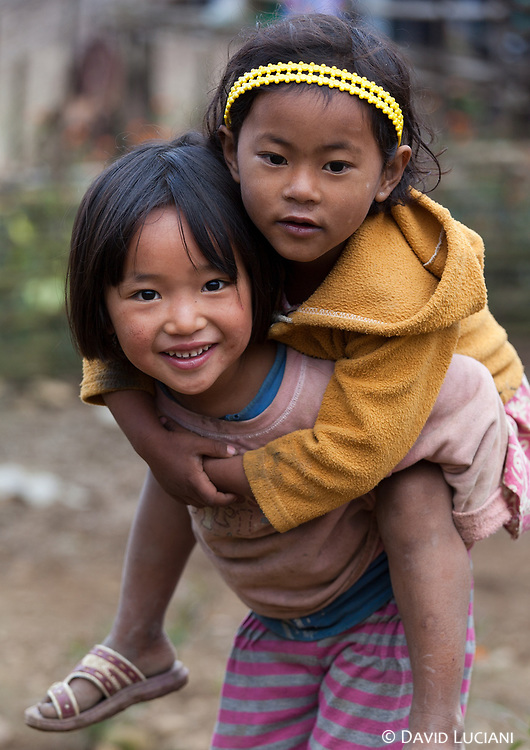 Two girls playing in Pangi village.