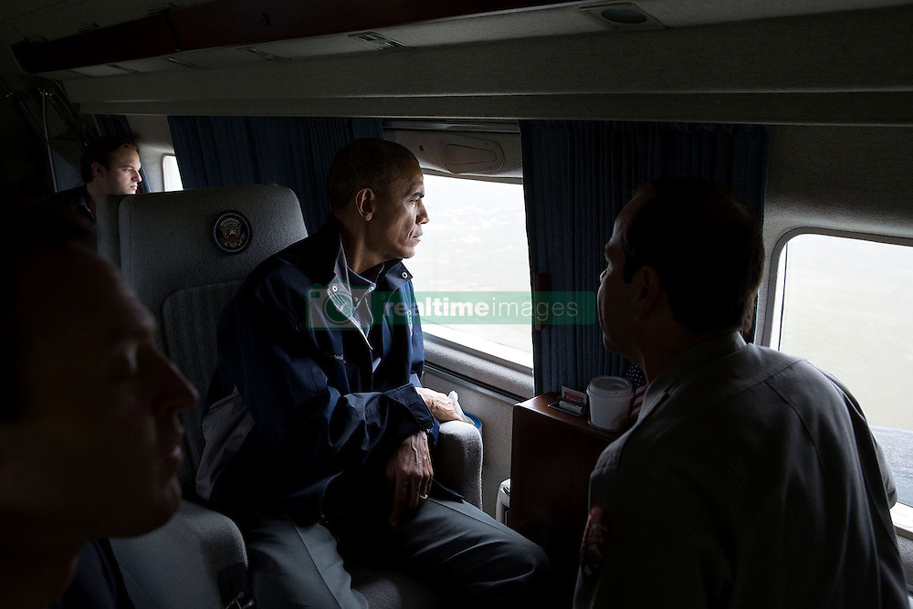 President Barack Obama views the Florida Everglades from Marine One with Pedro Ramos, Everglades National Park Superintendent, right, on Earth Day, April 22, 2015. (Official White House Photo by Pete Souza)<br /> <br /> This official White House photograph is being made available only for publication by news organizations and/or for personal use printing by the subject(s) of the photograph. The photograph may not be manipulated in any way and may not be used in commercial or political materials, advertisements, emails, products, promotions that in any way suggests approval or endorsement of the President, the First Family, or the White House.