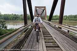 Alex Trepanier of California riding his single-cylinder single-speed 1913 Indian class-1 bike over the treacherous to motorcycles, wooden Wabash Cannonball Bridge in St. Francisville, Illinois during the Motorcycle Cannonball Race of the Century. Day-4 ride from Bloomington, IN to Cape Girardeau, MO. USA. Wednesday September 14, 2016. Photography ©2016 Michael Lichter.