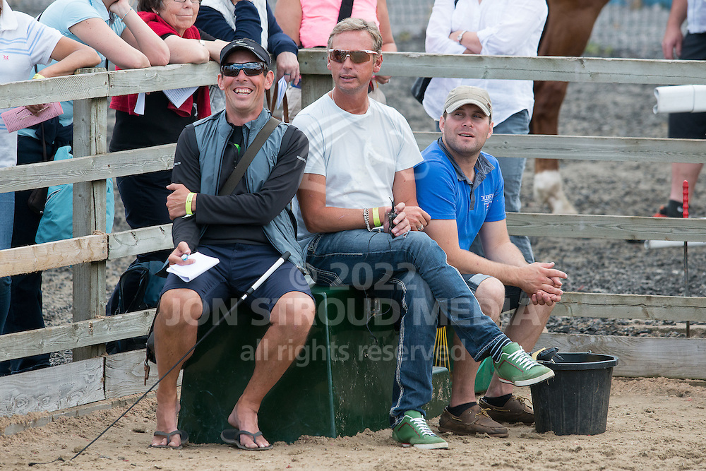 Charlotte Dujardin's back up team for the young horse classes (L-R) Ian Cast, Carl Hester and Tim Sillevis - Hartpury Festival of Dressage - Hartpury, Gloucestershire, United Kingdom - July 2015