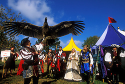 Stock photo of a man handling a giant bird at the Texas Renaissance Festival in Plantersville Texas