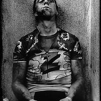 France, Roubaix, 12-04-1992.<br /> Cycling, From Paris to Roubaix.<br /> After the race is Greg Lemond, a rider from the USA who won the Tour de France three times and was two times winner of the world championships, completely exhausted sitting on a bench in the dressing room in Roubaix after his efforts to help his team mate Duclo-Lasalle to get the victory in this race.<br /> Photo:Klaas Jan van der Weij