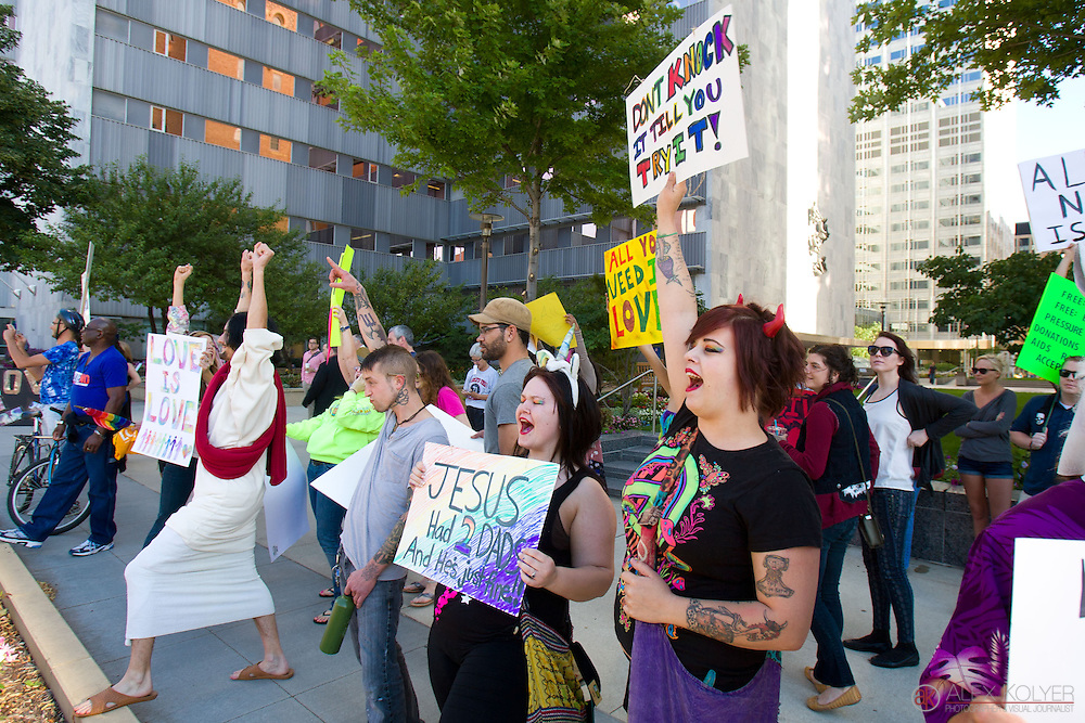 8/1/13--Rochester, Minn.<br /> Supporters of same-sex marriage protest the gathering of members of the Westboro Baptist Church outside the Mayo Clinic in Rochester Thursday, Aug. 1, 2013. The Westboro Baptist Church members came to protest Mayo's domestic-partner benefit policies on the first day of legalized same-sex marriages in Minnesota. Minnesota is the 12th state in the U.S. to legalize same-sex marriage. (Photo by Alex Kolyer)