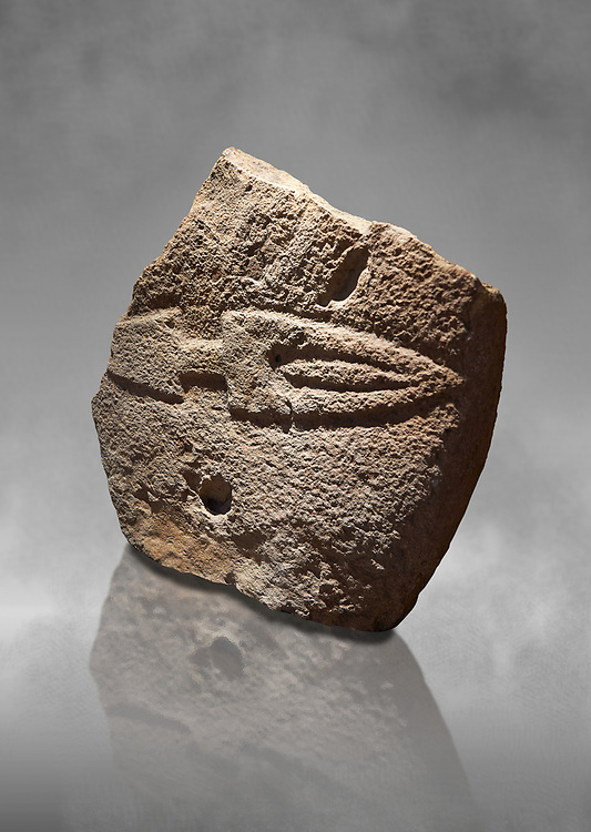 Fragmant of a Late European Neolithic prehistoric Menhir standing stone with carving of a knife on its face side.  Excavated from Palas de Nuraxi II, Laconi. Menhir Museum, Museo della Statuaria Prehistorica in Sardegna, Museum of Prehoistoric Sardinian Statues, Palazzo Aymerich, Laconi, Sardinia, Italy .<br /> <br /> Visit our PREHISTORIC PLACES PHOTO COLLECTIONS for more photos to download or buy as prints https://funkystock.photoshelter.com/gallery-collection/Prehistoric-Neolithic-Sites-Art-Artefacts-Pictures-Photos/C0000tfxw63zrUT4
