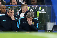 Manuel Pellegrini , manager of Manchester City looking dejected during the 2nd half where the score was 5-1. The Emirates FA Cup, 5th round match, Chelsea v Manchester city at Stamford Bridge in London on Sunday 21st Feb 2016.<br /> pic by John Patrick Fletcher, Andrew Orchard sports photography.