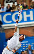 Australia's Lleyton Hewitt  serves to Croatia's Martin Cilic, during their semifinal match for the Aegon Championships at the Queen's Club in London, Britain, 15 June 2013. The play was suspended due to rain for the second time in set one, with Martin Cilic wining the first two games. EPA/BOGDAN MARAN