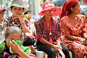 """17 MAY 2010 - BANGKOK, THAILAND: Women at the Red Shirt stage started weeping when they heard that their highly respected unofficial military leader, Seh Daeng, has died Monday. The Thai government announced Monday that renegade army general and the Red Shirts unofficial military commander and staunch supporter, Thai Army Maj. Gen. KHATTIYA """"Seh Daeng"""" SAWASDIPOL, died Monday from wounds he suffered when a sniper shot him in the head on May 12 while he was being interviewed by an American reporter. When the announcement was read to the Red Shirt protesters still camped out in Ratchaprasong intersection in Bangkok many started weeping.   PHOTO BY JACK KURTZ"""