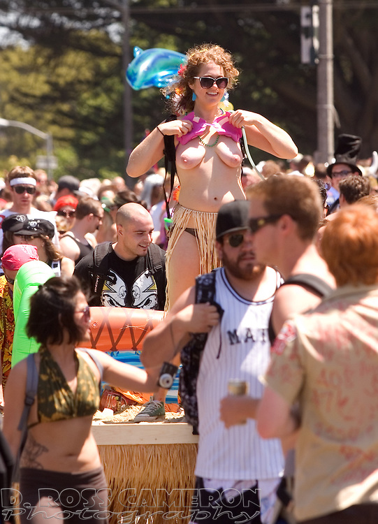 An unidentified woman dances topless on a float at the 98th running of the Bay to Breakers footrace in San Francisco, Sunday, May 17, 2009. (Photo by D. Ross Cameron)