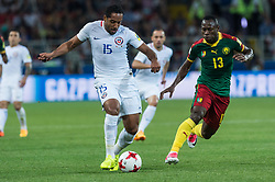 Jean Beausejour of Chile (C) vies for the ball with Christian Bassogog of Cameroon (R) during the FIFA Confederations Cup-2017 football match in group B between Cameroon and Chile in Moscow, Russia, on June 18, 2017. (Credit Image: © Evgeny Sinitsyn/Xinhua via ZUMA Wire)