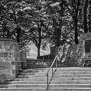 Not quite a stairway to heaven.  Climb these stairs to get to the highest point in Manhattan in Fort Tryon Park.  This park is filled with history.  You can see one of the plaques on the wall tot he right.