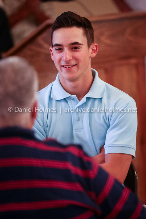 (8/11/16, MILFORD, MA) Player Shawn Rebello visits with a parent during the Milford American Legion baseball banquet at Hoboken Citizens Club in Milford on Thursday. Daily News and Wicked Local Photo/Dan Holmes