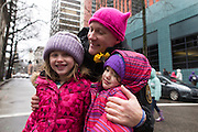 Portland Police Bureau officer Dan Spiegel poses with two young girls in the Women's March on Portland on Saturday, Jan. 21, 2016 in downtown Portland, Ore. The march was held in support of a national women's march held in Washington, D.C.  Photo by Randy L. Rasmussen, © 2017.