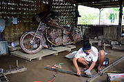 BOYOLALI, INDONESIA - MARCH 09: <br /> <br /> Replica Harley Davidson<br /> <br /> Craftsman finish making a replica Harley Davidson with copper and brass materials at AA Gallery workshop on March 09, 2015 in Boyolali, Central Java, Indonesia. Process of replica bike takes approximately 2 months. This replica will be sent to Europe.<br /> ©John Sumbar/Exclusivepix Media